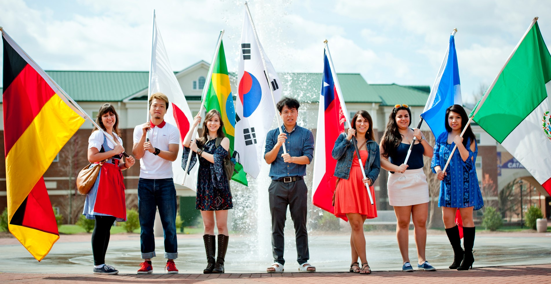 Students holding flags of different countries