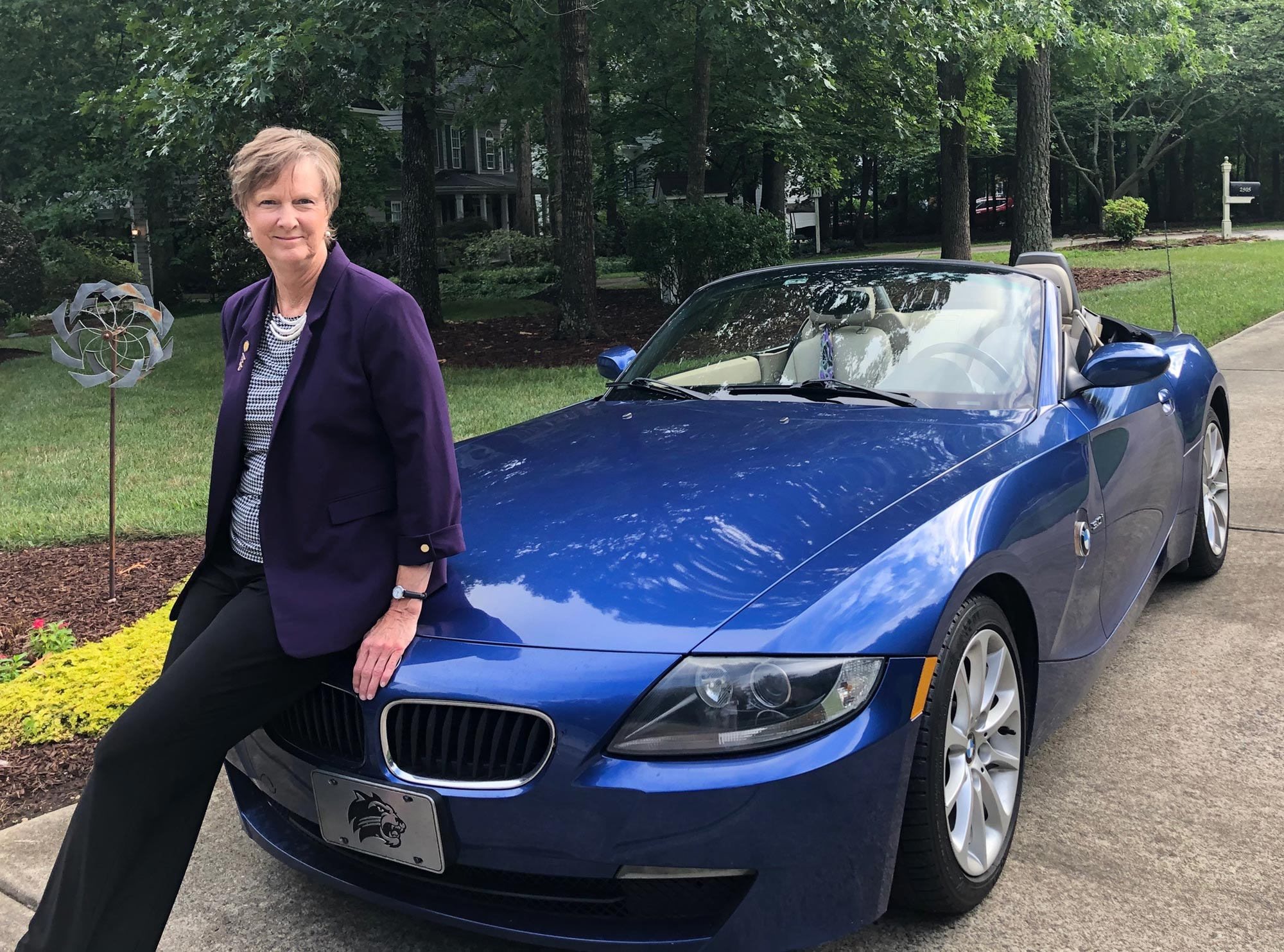 Donna Winbon and her blue BMW convertable