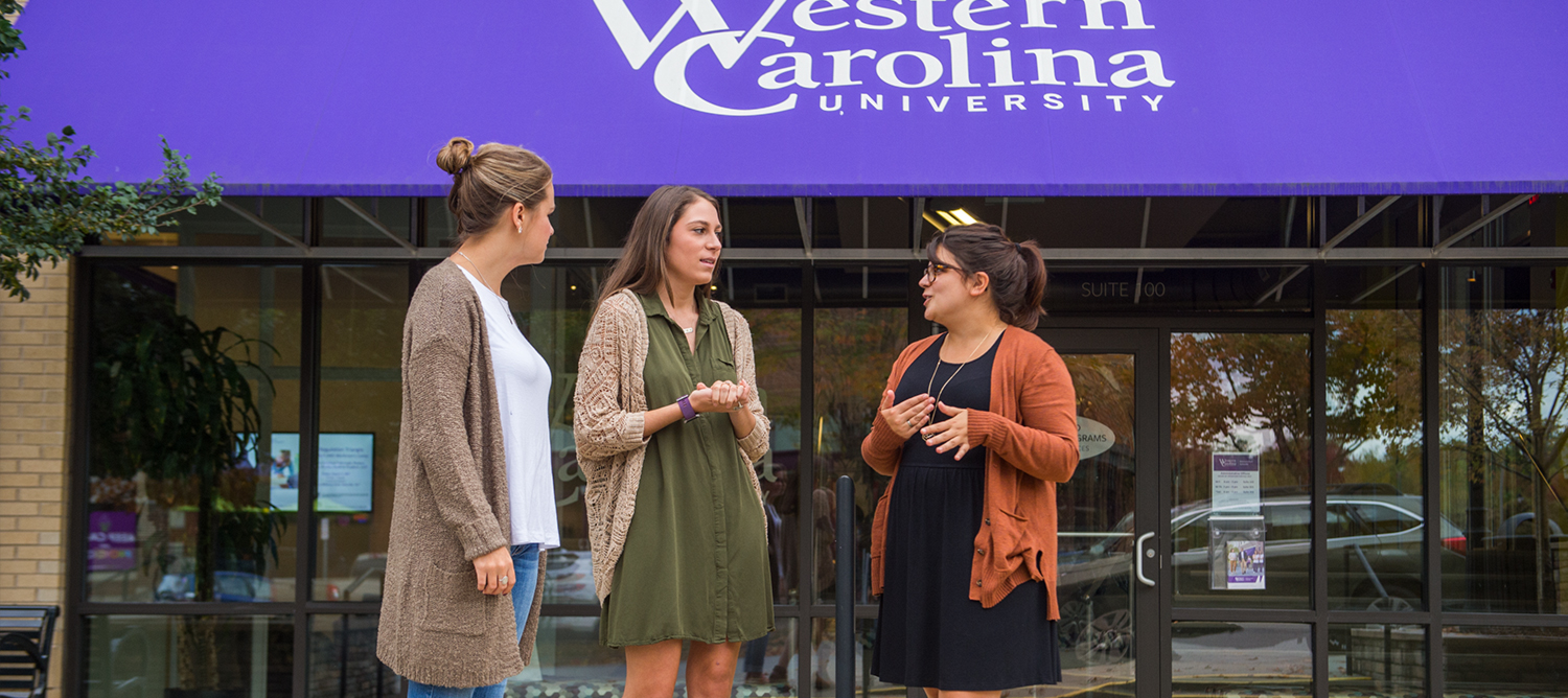 Students in front of WCU in Asheville at Biltmore Park