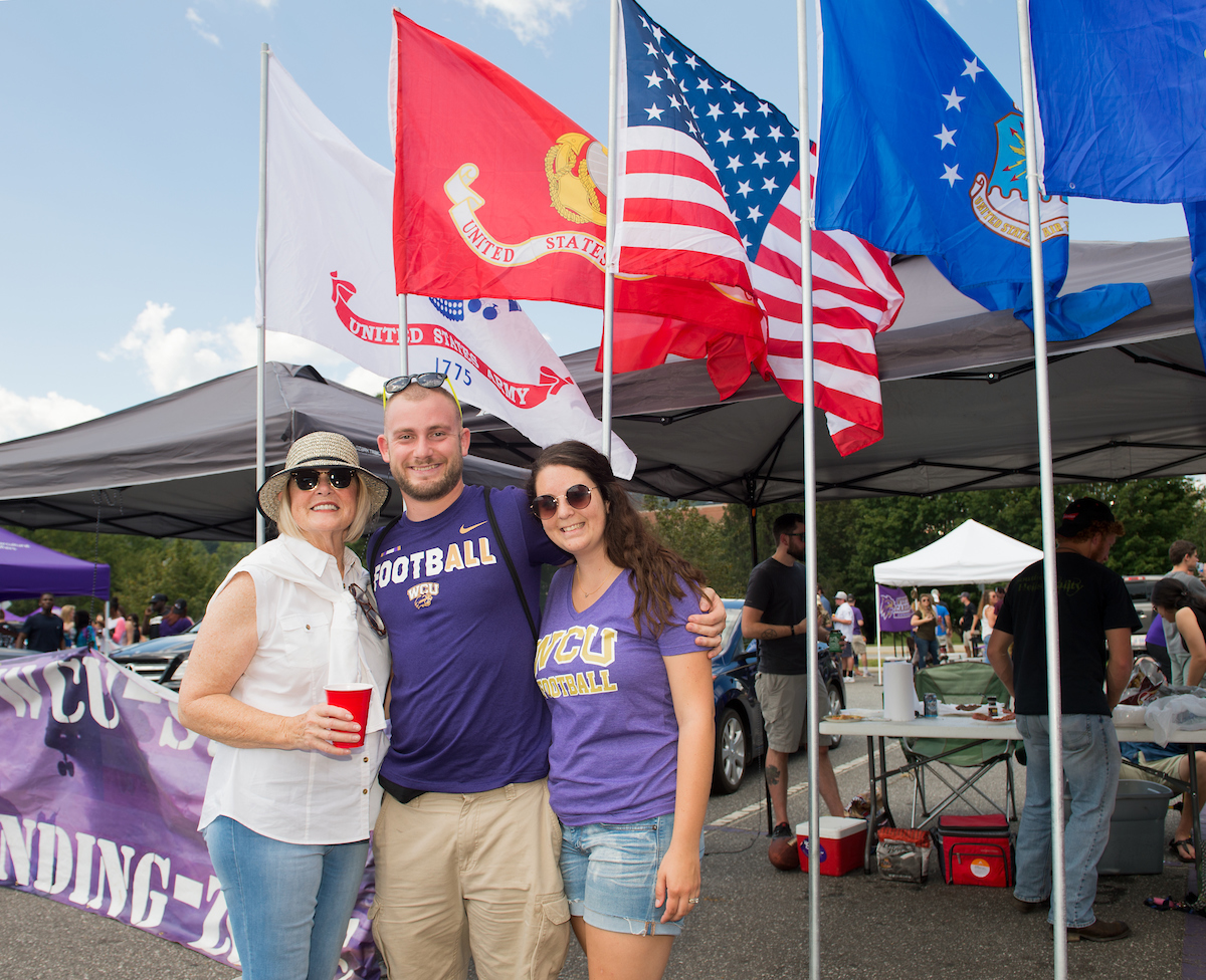 Students enjoy tailgating before a football game