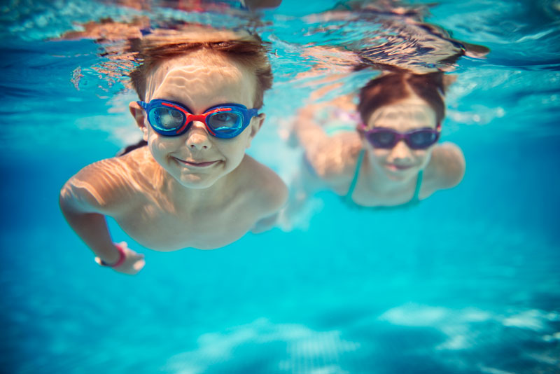 two boys swimming underwater