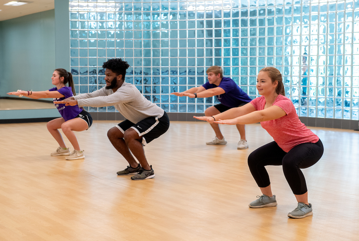 Student in a group exercise class