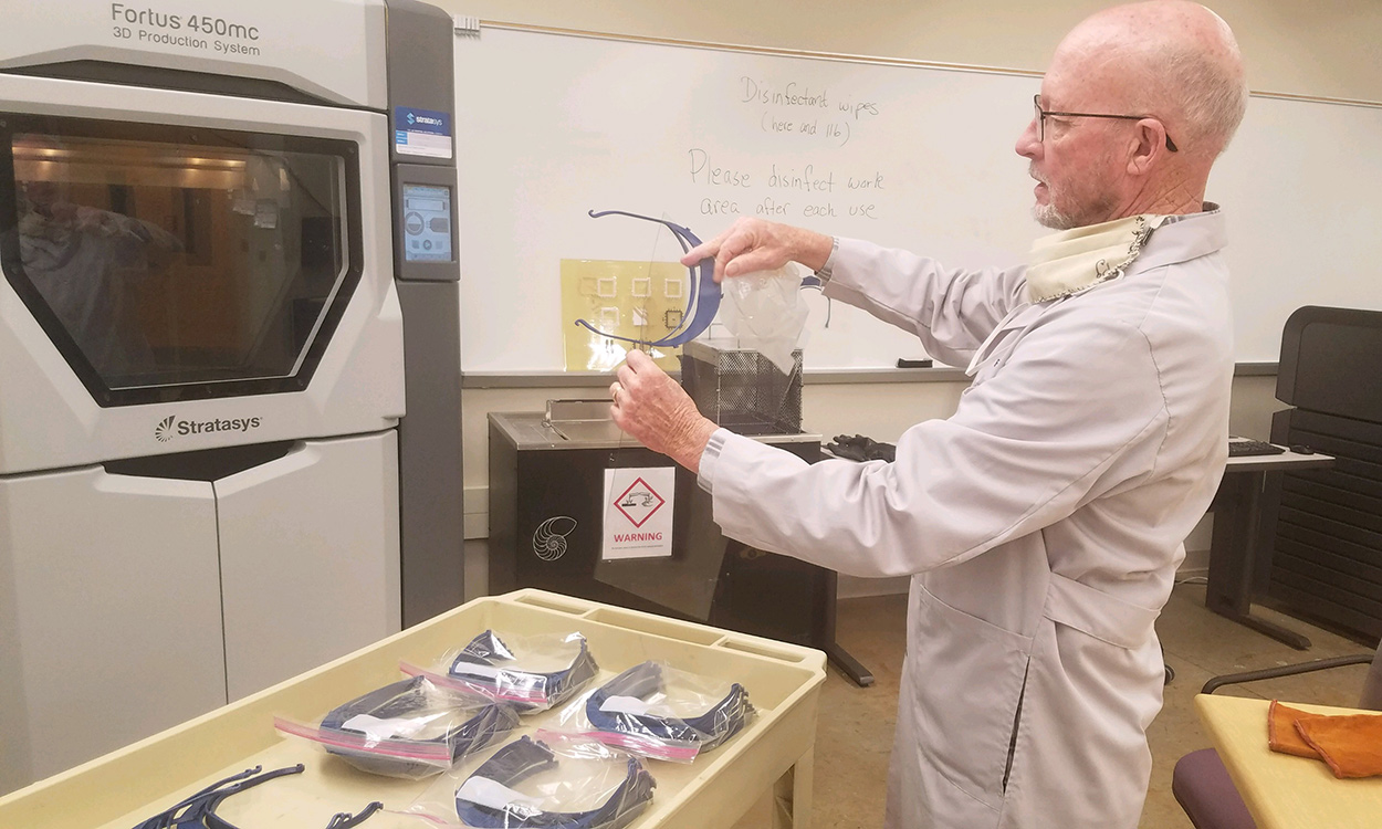 atrick Gardner, director of the Rapid Center in Western Carolina University's College of Engineering and Technology, examines a set of 3D printer-generated face shield visors that will be sent to health care workers as part of a national initiative to provide personal protective equipment during the COVID-19 crisis.