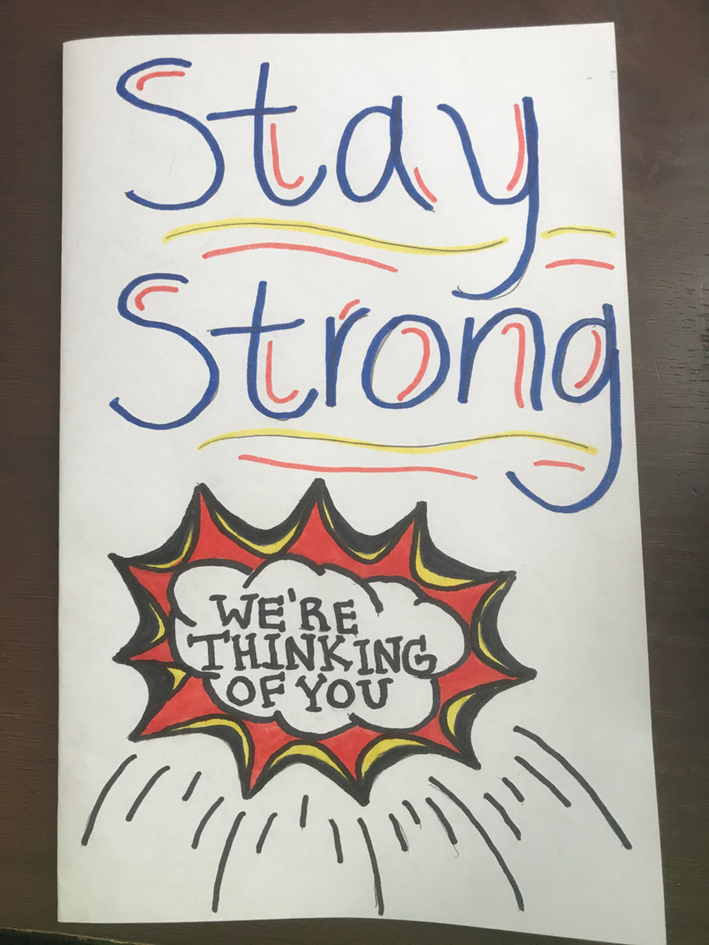 "A card depicting ""stay strong"""