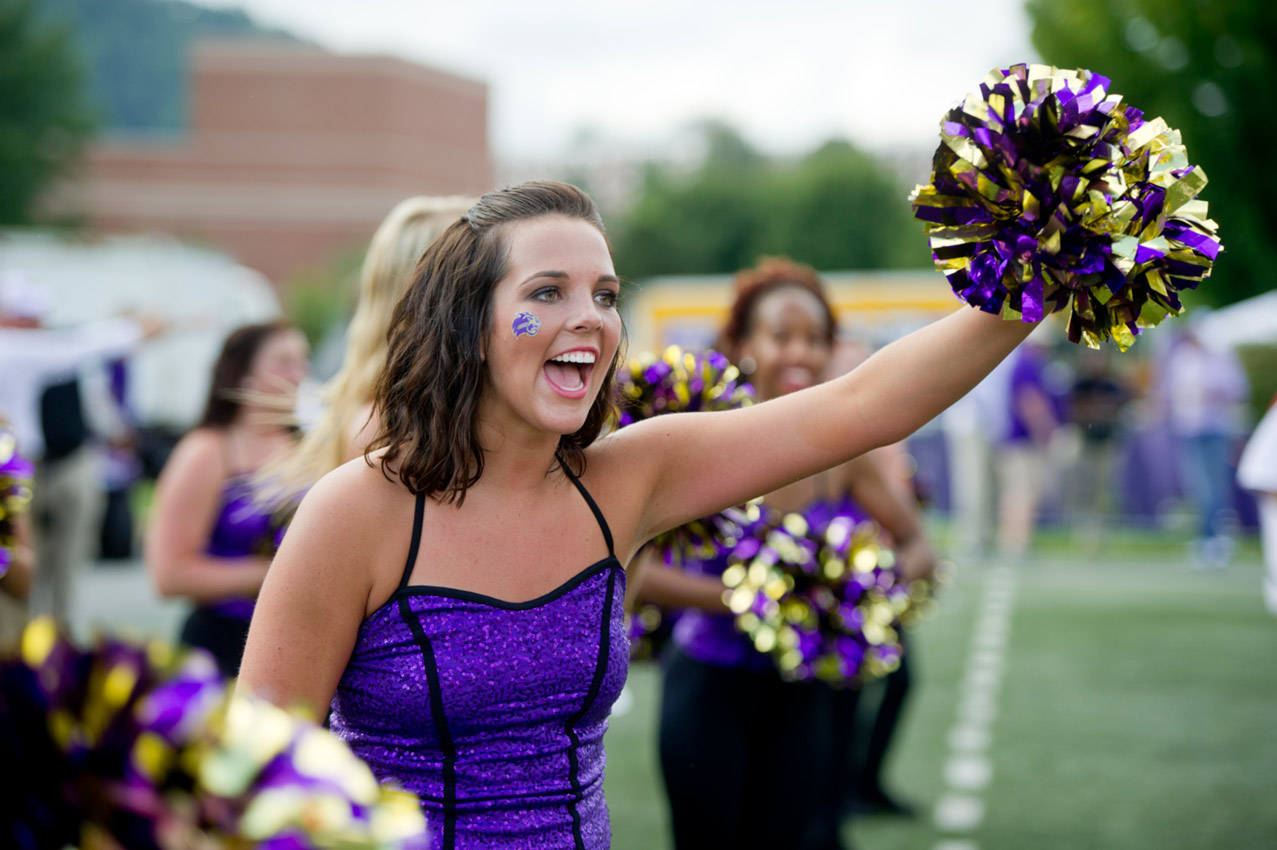 Former WCU Student Amber Parker cheering on the field for the football team