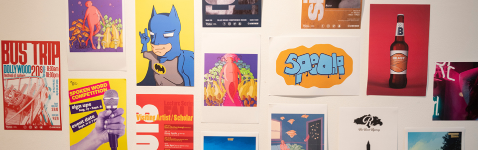 An image of different types of student work from the graphic design program hanging in a gallery.