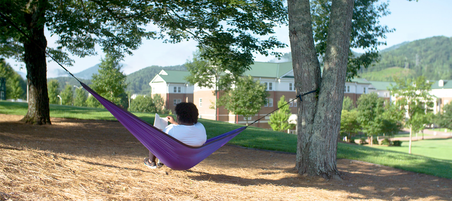 Student in a hammock on campus