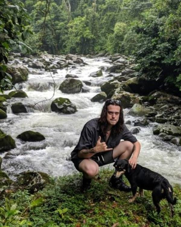 JCrunk with dog infront of a river in Costa Rica