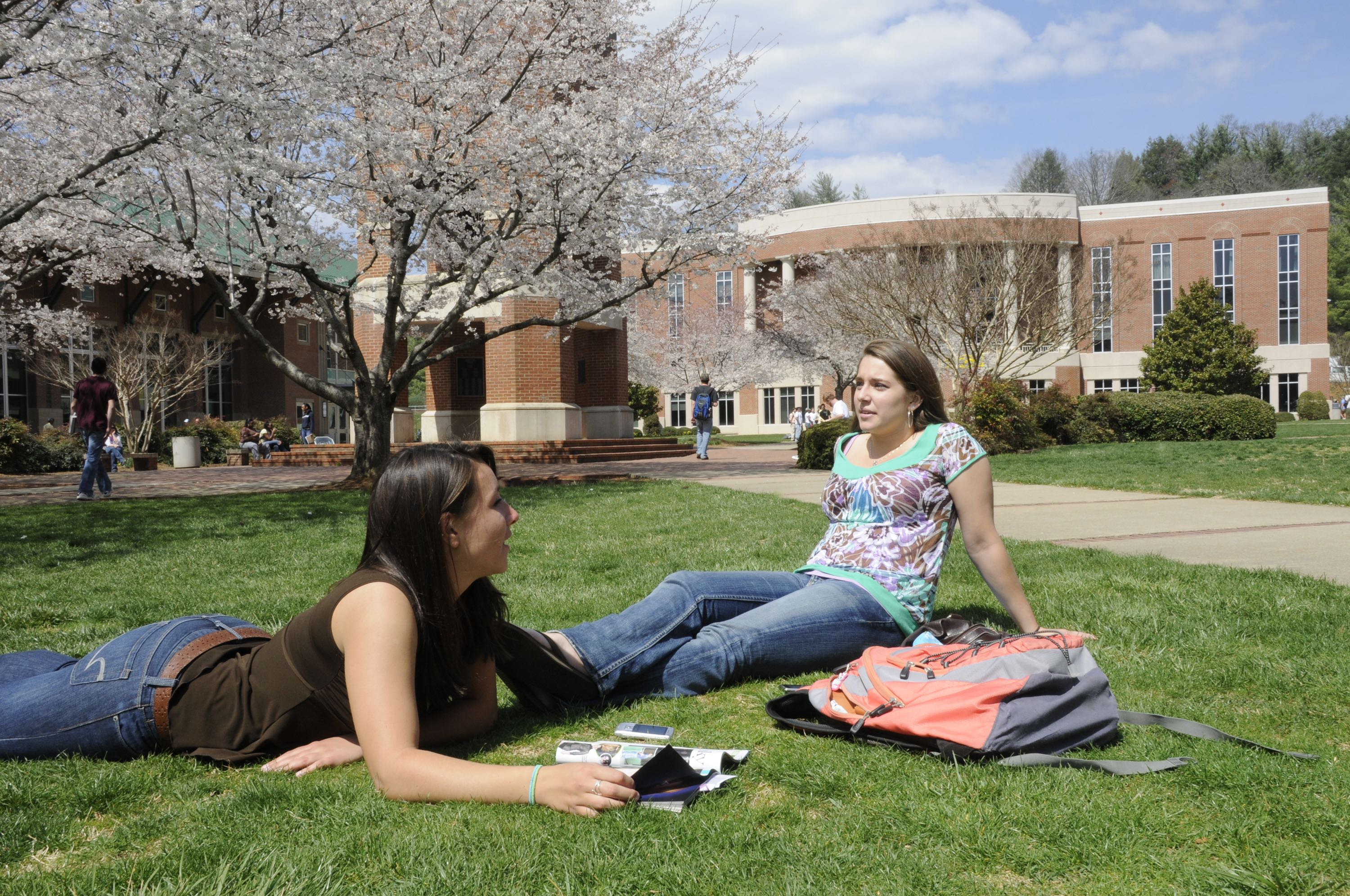 Learning Communities Two students sitting outside laughing