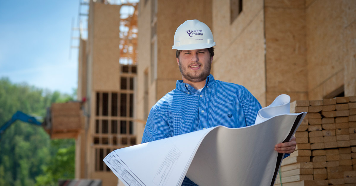 Man in a Hardhat with Blueprints