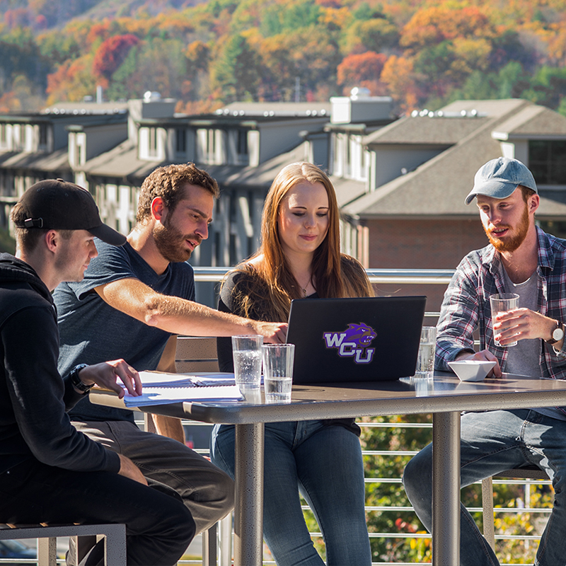 Students Studying on a roof top patio at Brown Hall