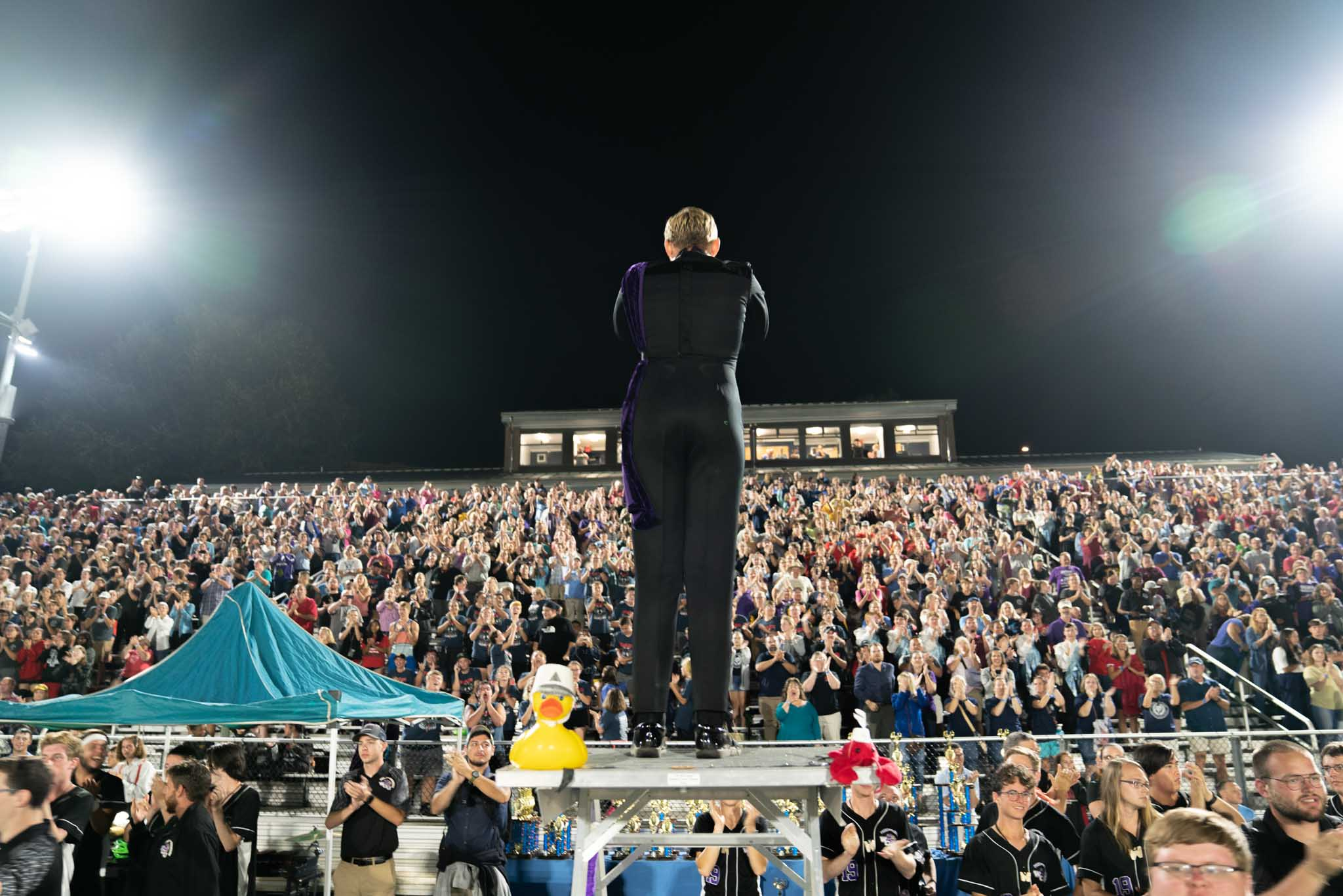 Drum major bows to crowd.
