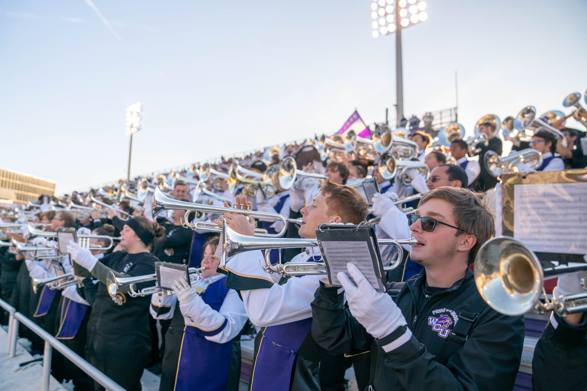 Marching band plays in the stands.