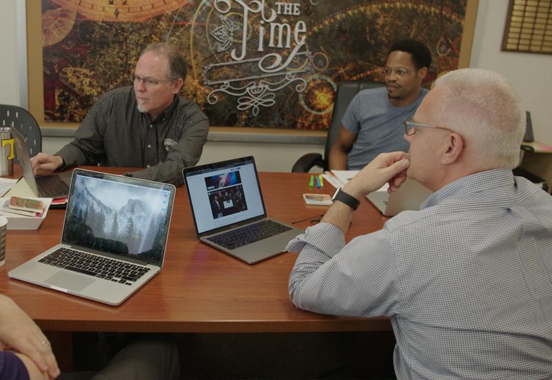 Band directors discuss show design.