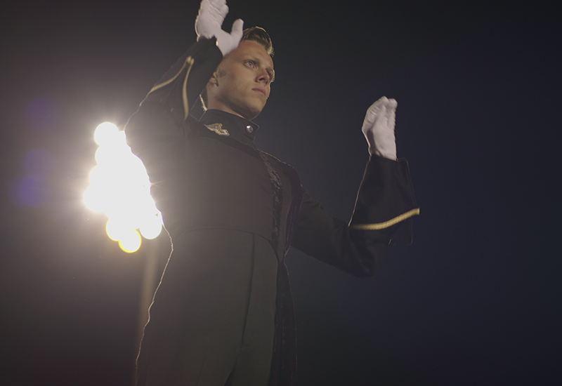 Band student directs halftime show.