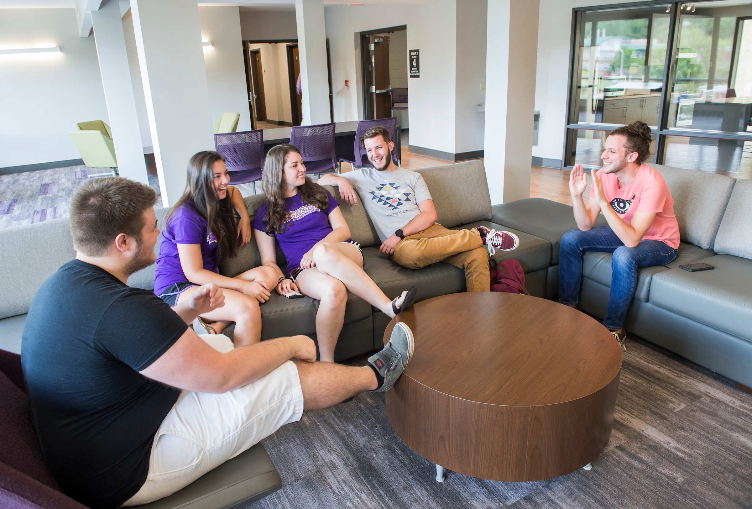 Students spending time, hanging out together in the common area of a Residence Hall