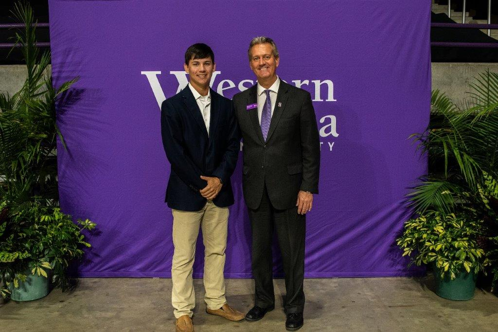 student scholarship recipient stands with Director of Alumni Engagement