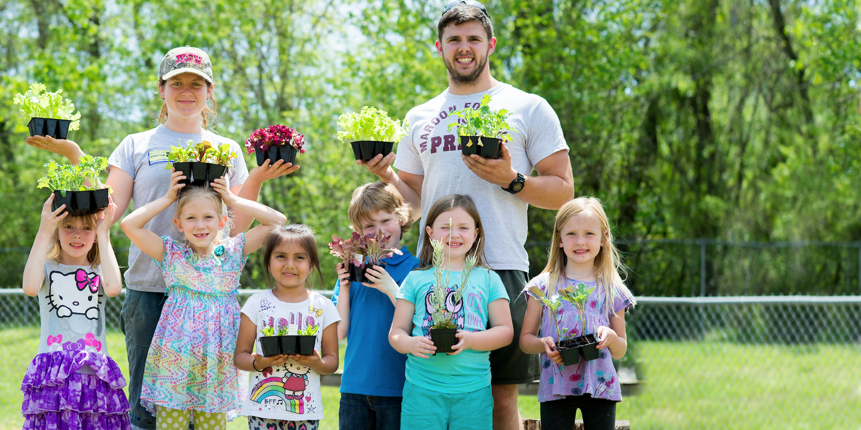 Students from Western Carolina University working with Elementary School Students in the Kinder-Garden to teach them about nutrition, agriculture and biology