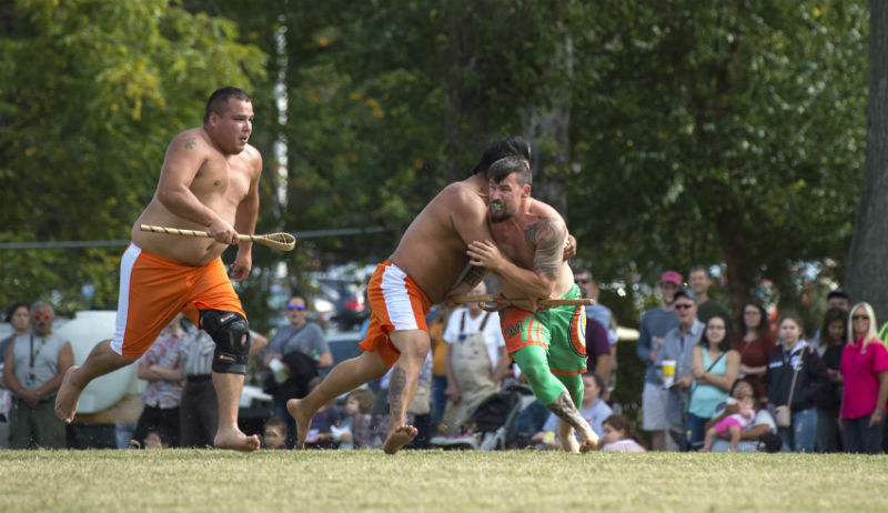 Members of the Eastern Band of the Cherokee Indians playing stickball.