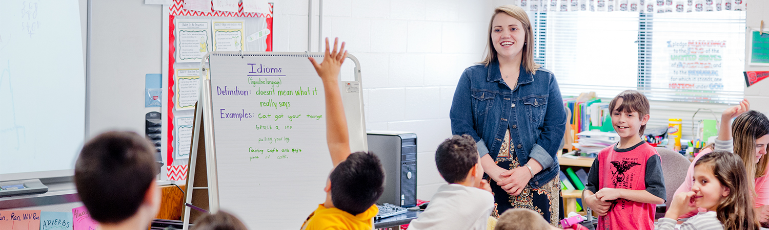 A WCU Alum teaching in a classroom