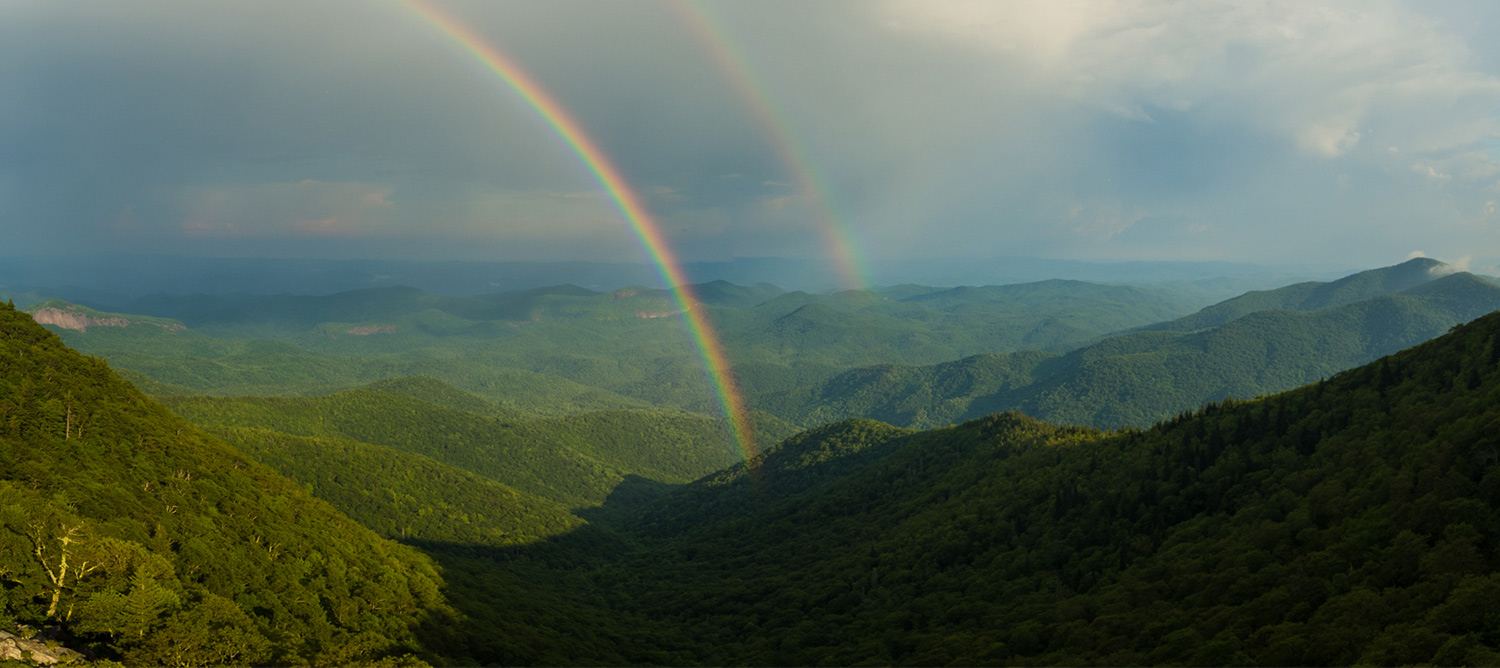 Photo of mountains with a rainbow