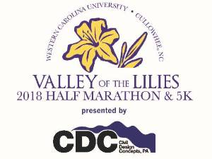Valley of the Lilies Half Marathon and 5k logo featuring a yellow liliy and presented by the CMI Design and Concepts