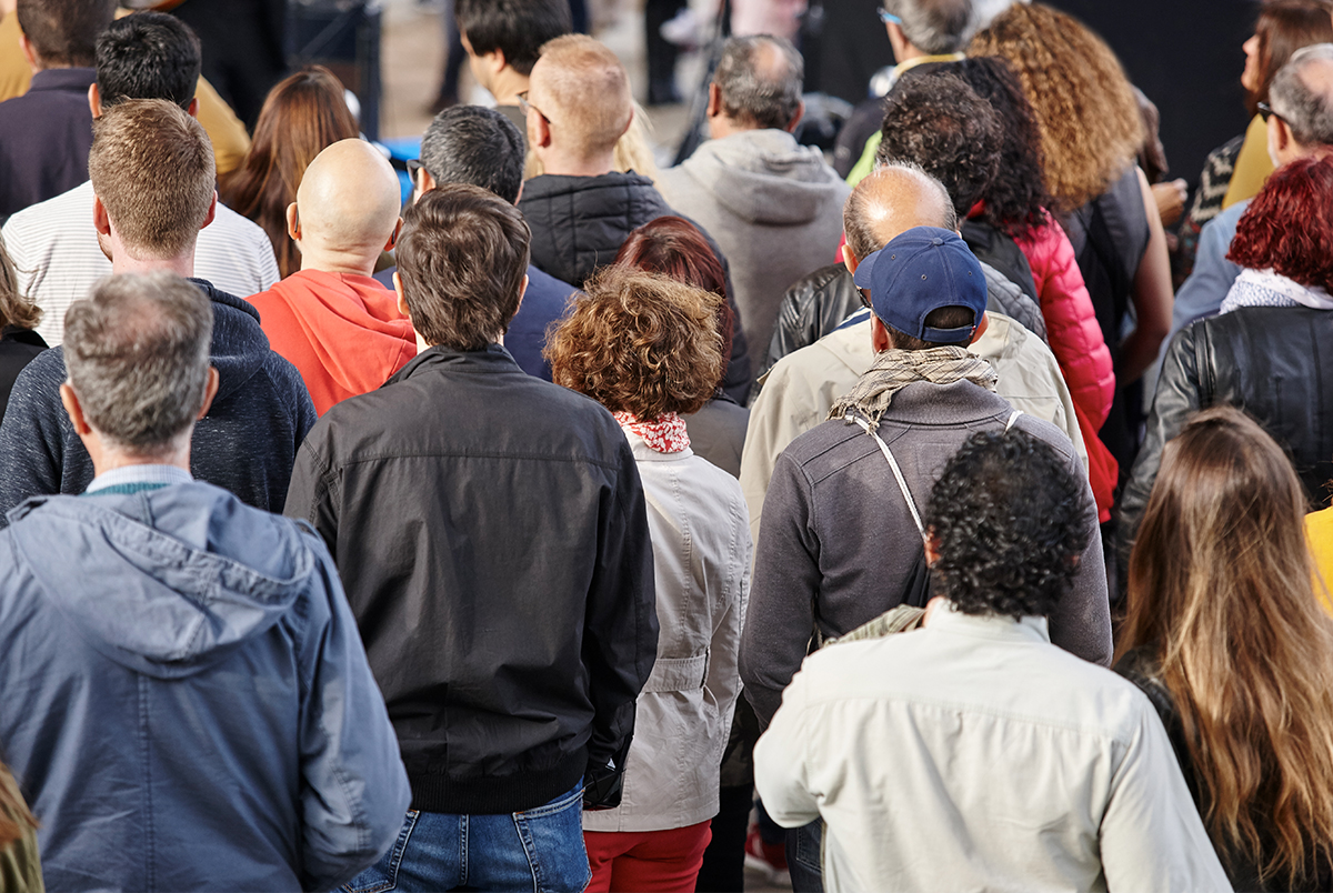 Economics Dashboard: Demographics - People standing in a crowd