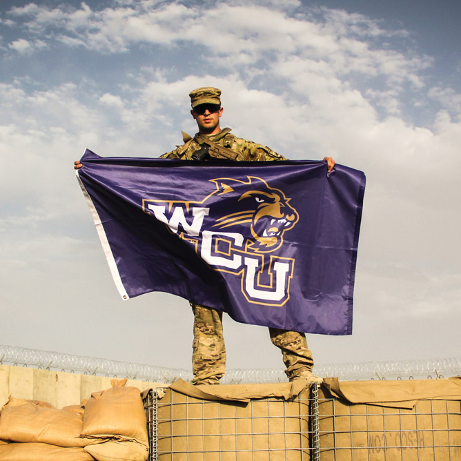 Military student with WCU flag