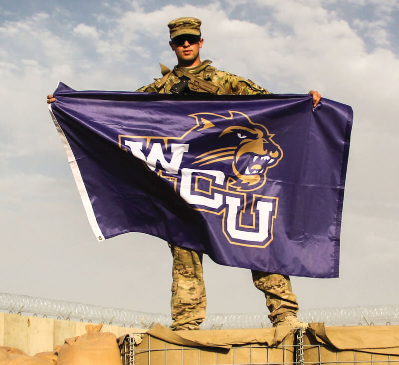 Soldier with WCU flag