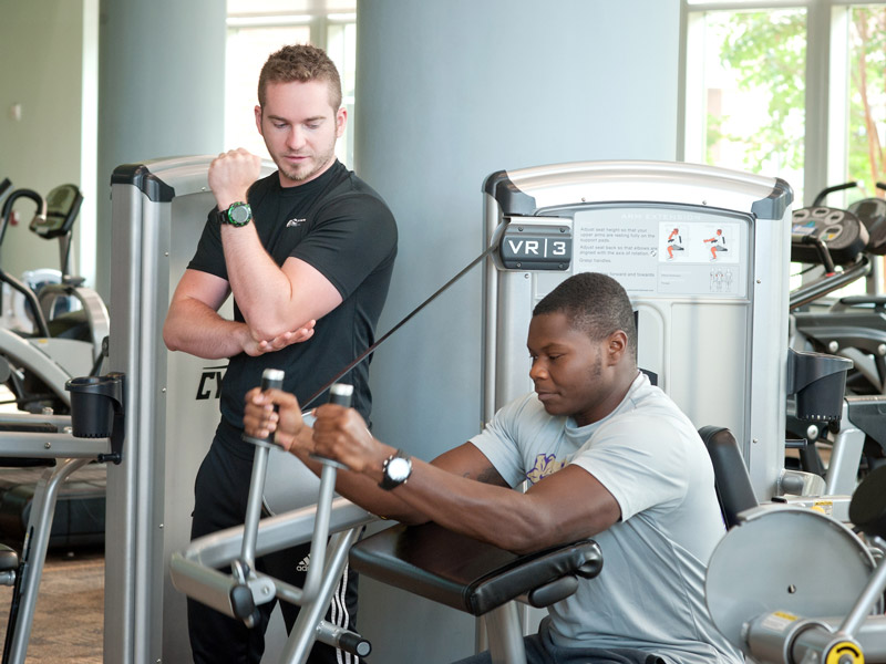 two men working with exercise equipment