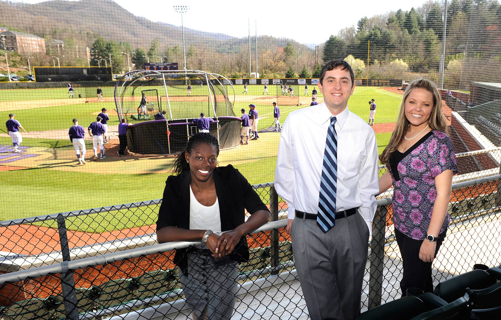 Sport Management students in front of baseball field