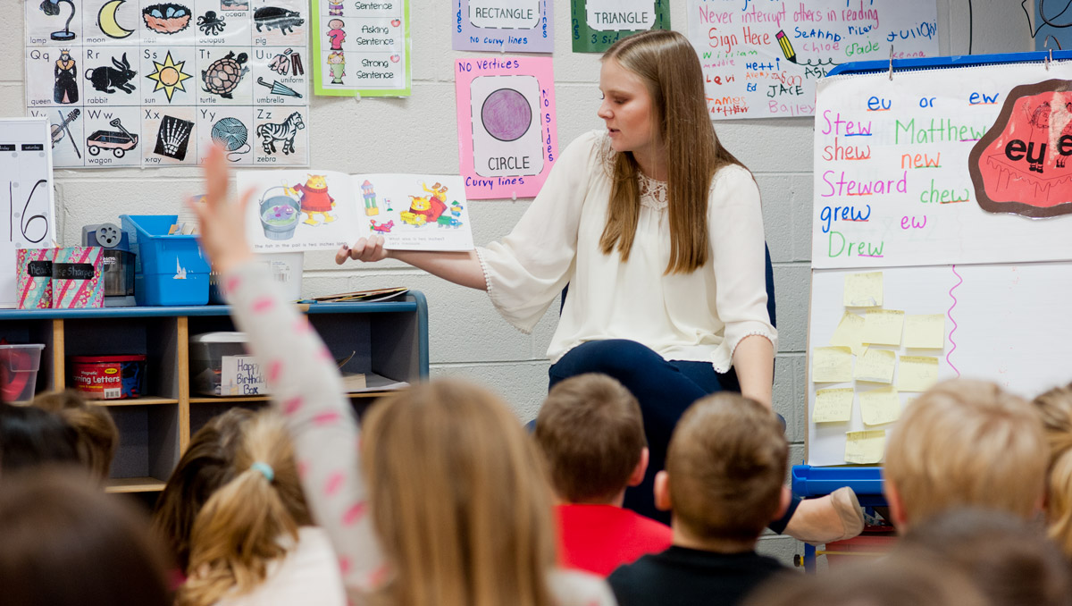 Elementary Education Student-Teacher in classroom with kids