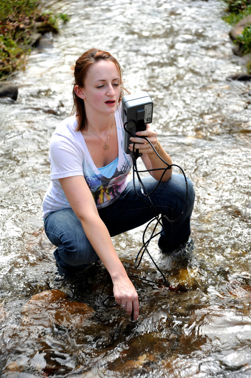 Environmental Health Student conducting research in a creek