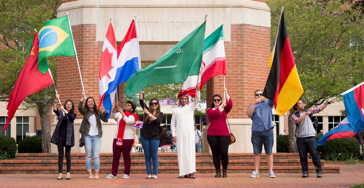 international festival day - students with international flags