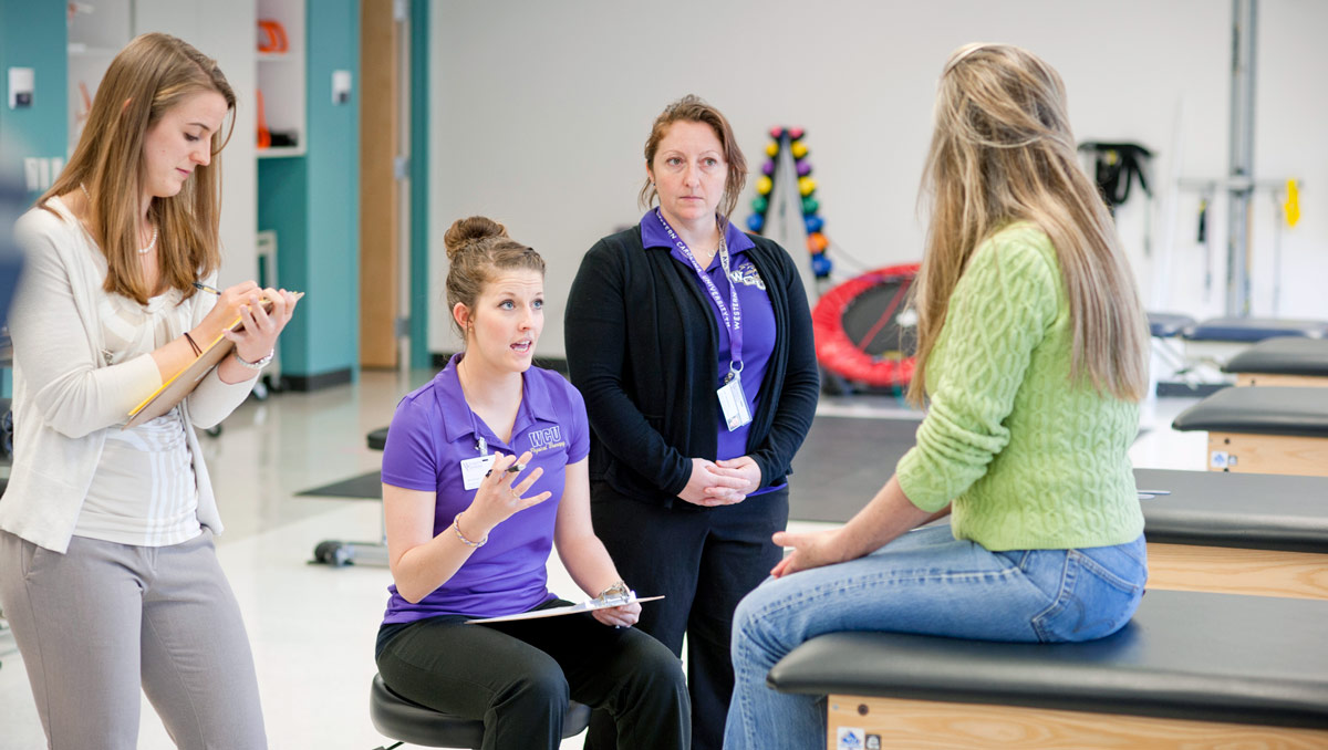 Students working in the physical therapy clinic
