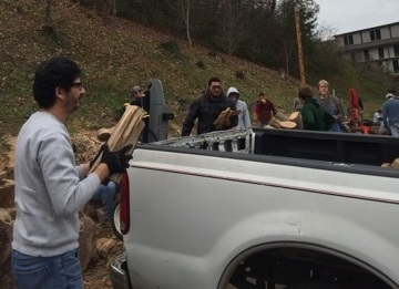Intercultural Dialogue group cutting and delivering wood