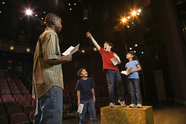 Kids practicing lines for a play