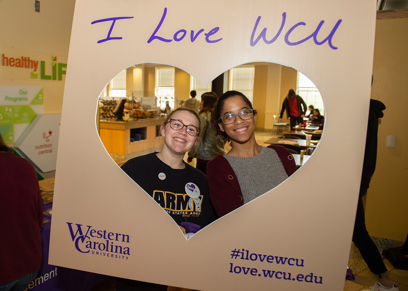 Students with a I Love WCU photo frame