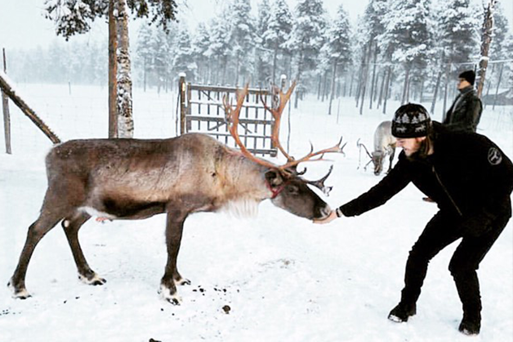 Student with a reindeer in finland