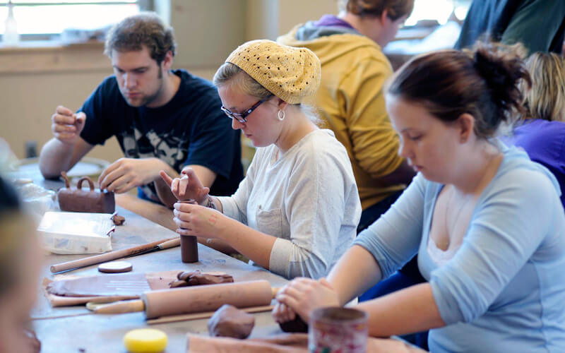 Students work with clay in a Ceramics class