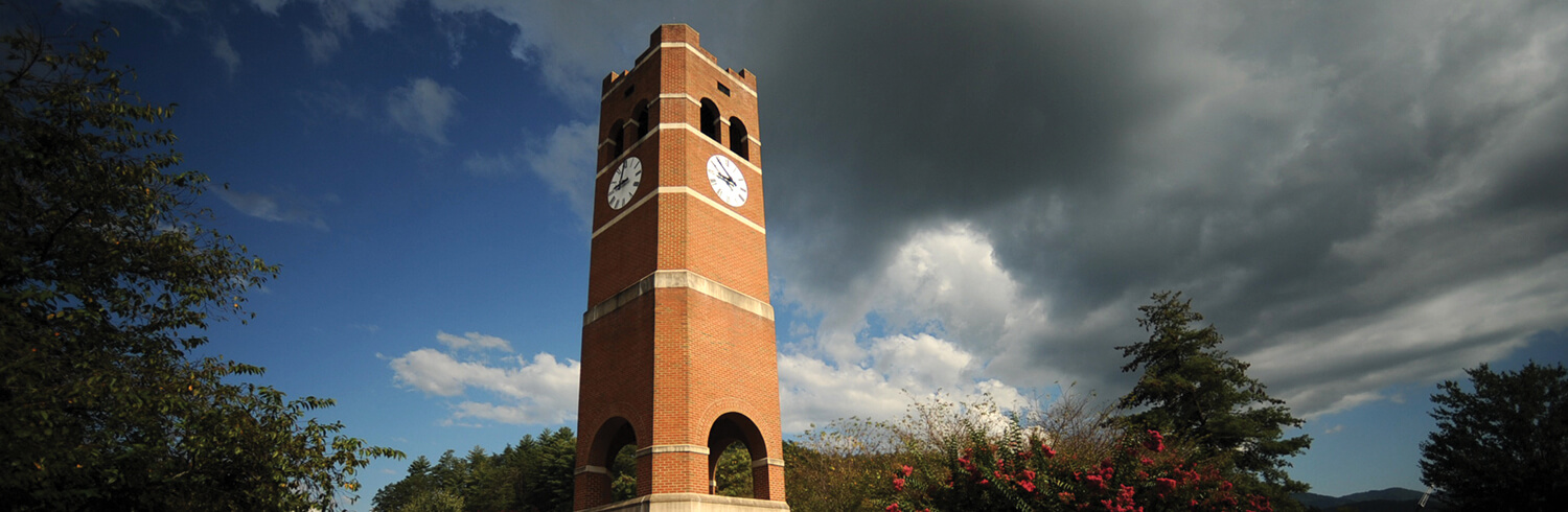 A image of the alumni tower on campus as the background of a clickable button