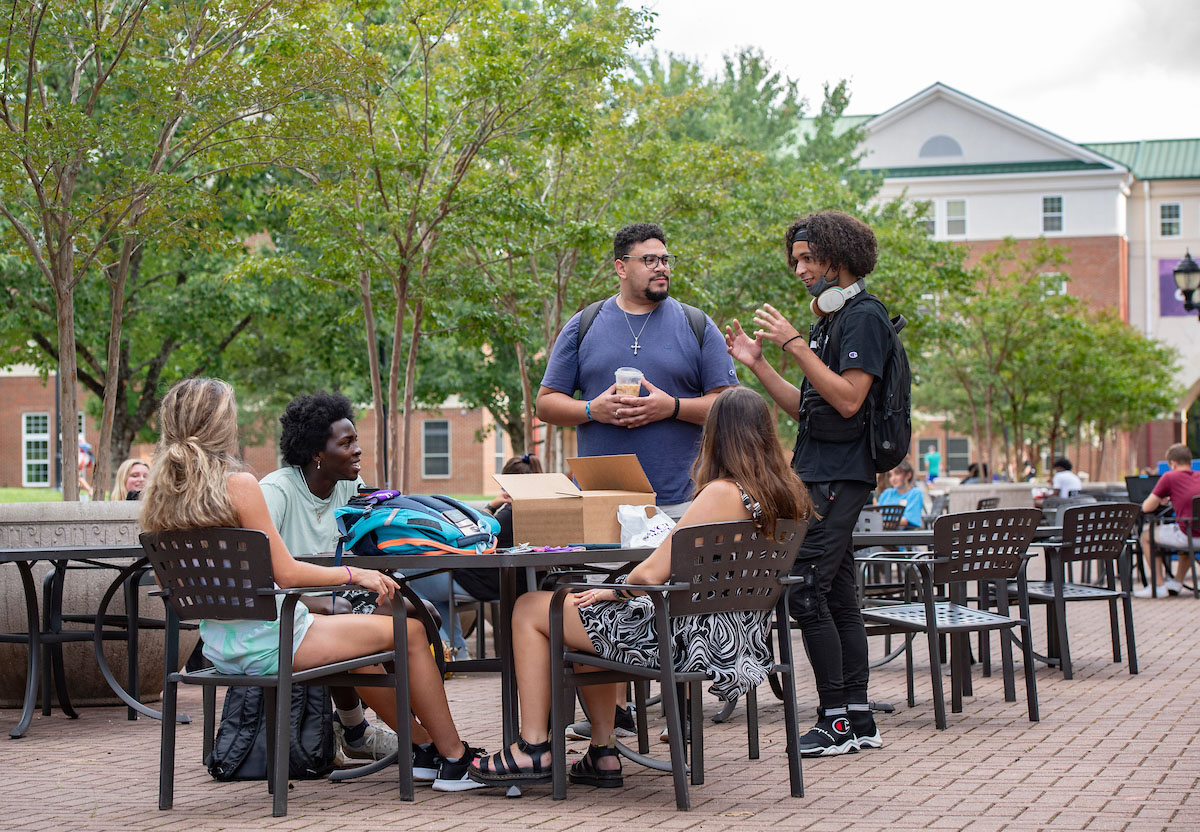 WCU students talking at table
